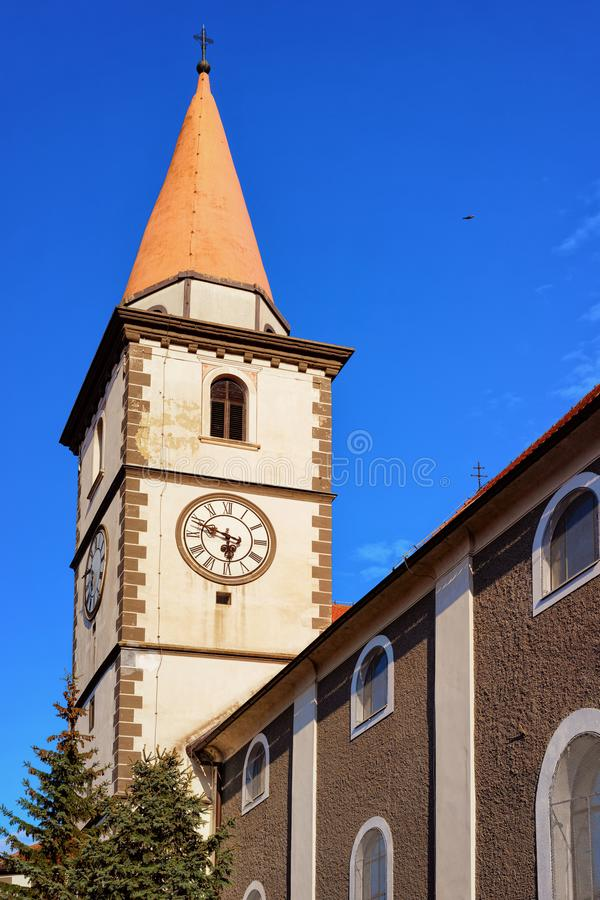 Clock tower of St Nicholas Church of Varazdin in Croatia. Clock tower of St Nicholas Church in Old city of Varazdin in Croatia. Cityscape with belfry in famous stock photos