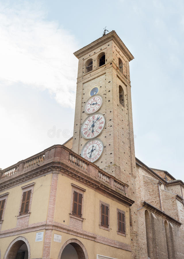 Clock tower of Tolentino - Italy. TOLENTINO, ITALY- AUGUST 19: the ClockTower built in 1822, has four quadrants indicating moon phase, the hours, the royalty free stock photography