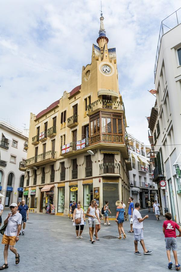 Clock tower on top of apartments in Sitges. Clock tower on top of apartments, Sitges,Spain .Bartomeu Carbonell house aka the clock house Casa del Rellotge stock image
