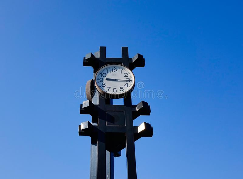 Clock tower under blue sky in Tokyo, Japan stock images