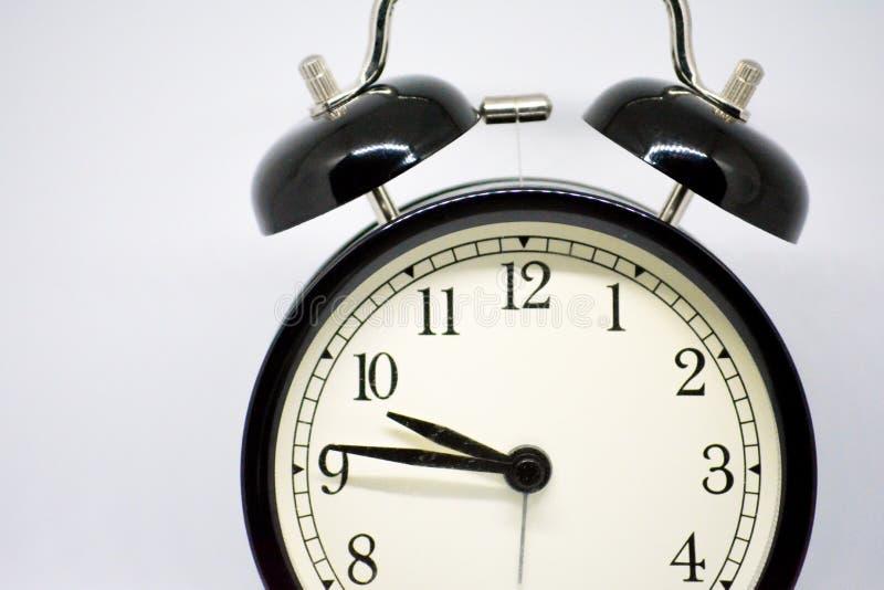 Clock vänder mot royaltyfria bilder