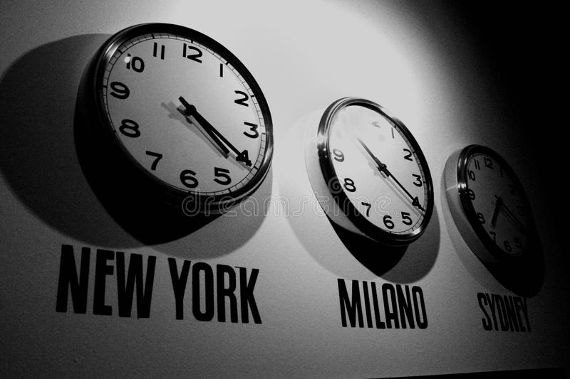 Clock on the wall in b/w format stock image