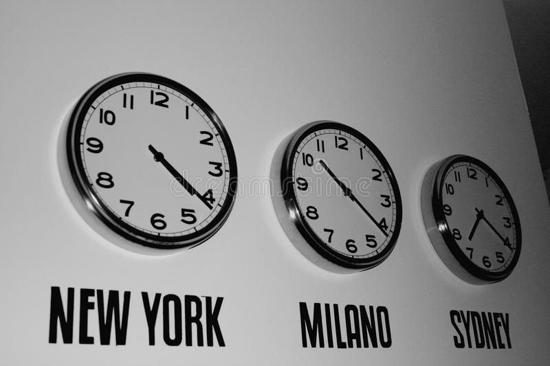 Clock on the wall showing time in the world royalty free stock images