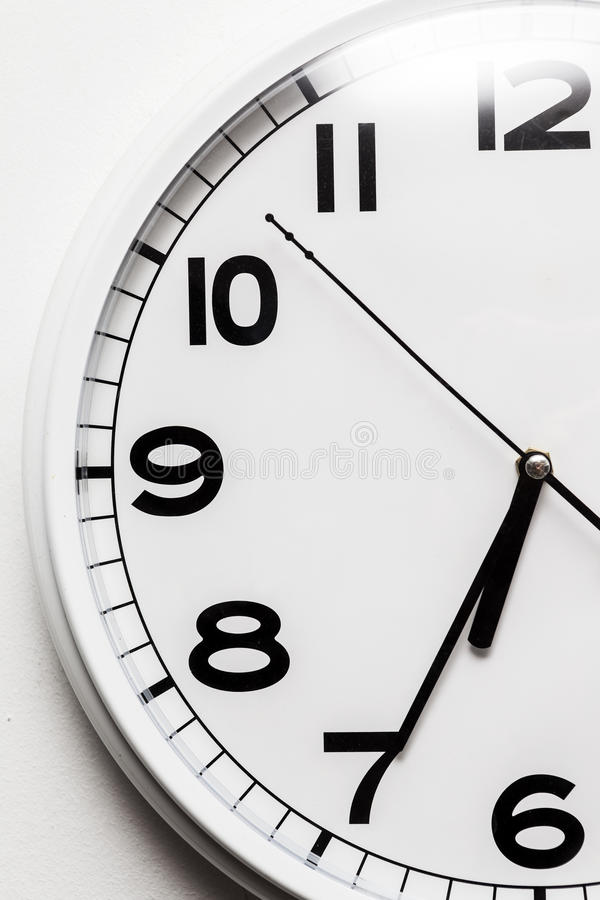 Clock. White wall clock detail view stock photo