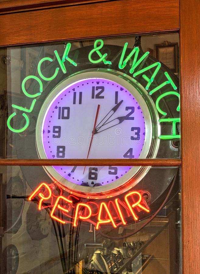 Clock and watch repair shop stock photo
