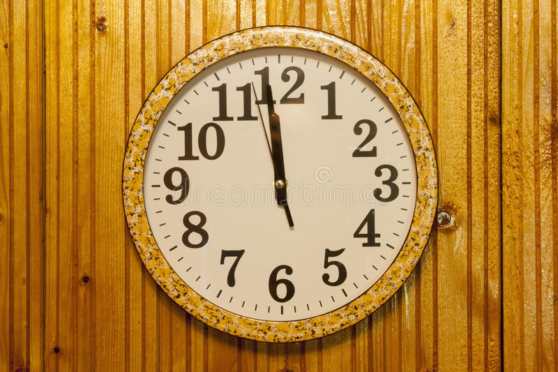 Clock on wooden wall stock photos
