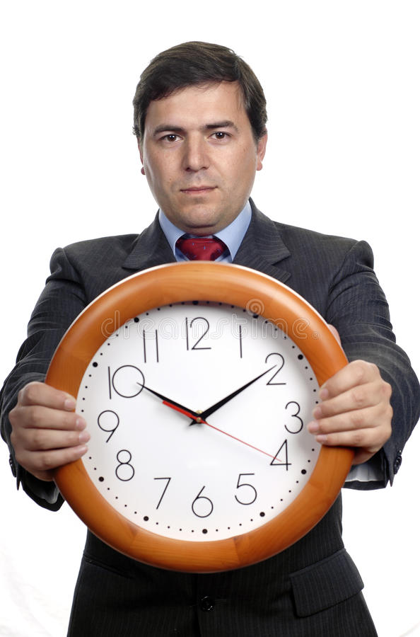 Clock. Young handsome business man holding a clock royalty free stock photos
