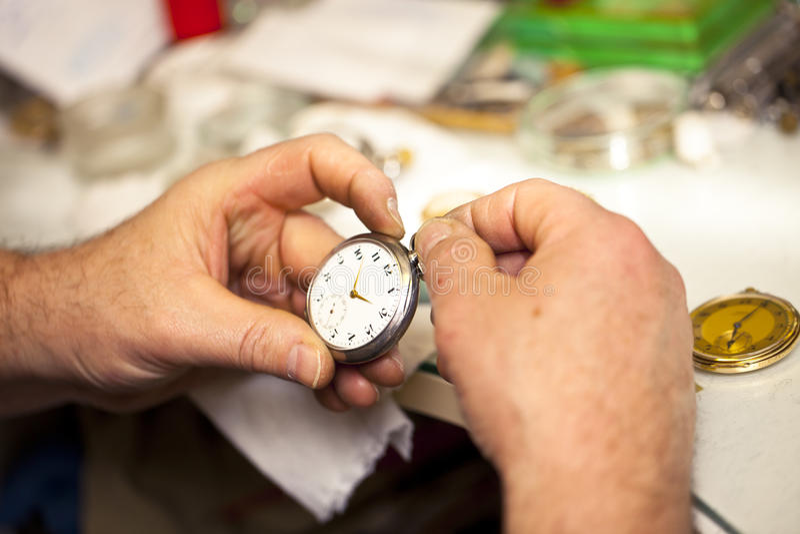 Clockmaker. In his workshop repairing royalty free stock photo