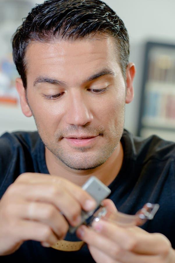 Clockmaker repairing wrist watch. Man royalty free stock image