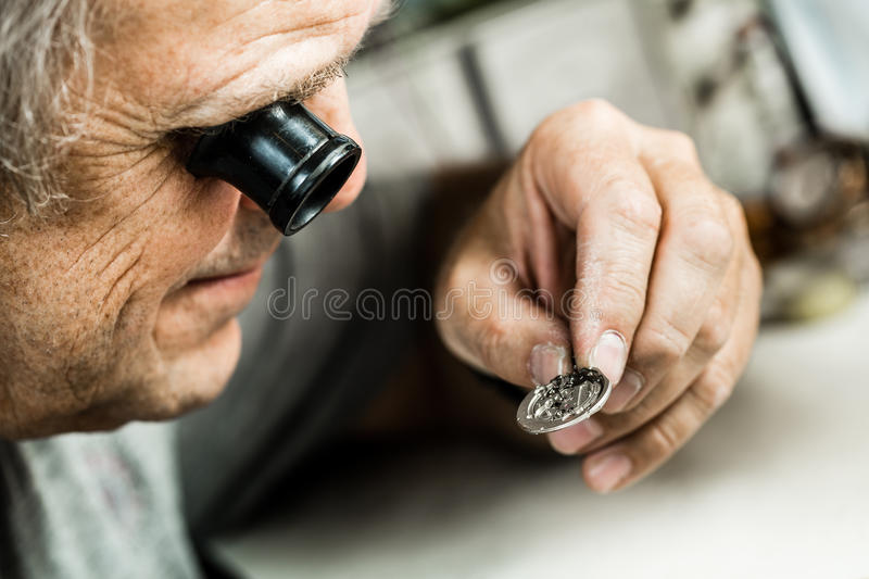 Clockmaker repairing wrist watch. Selective focus royalty free stock photography