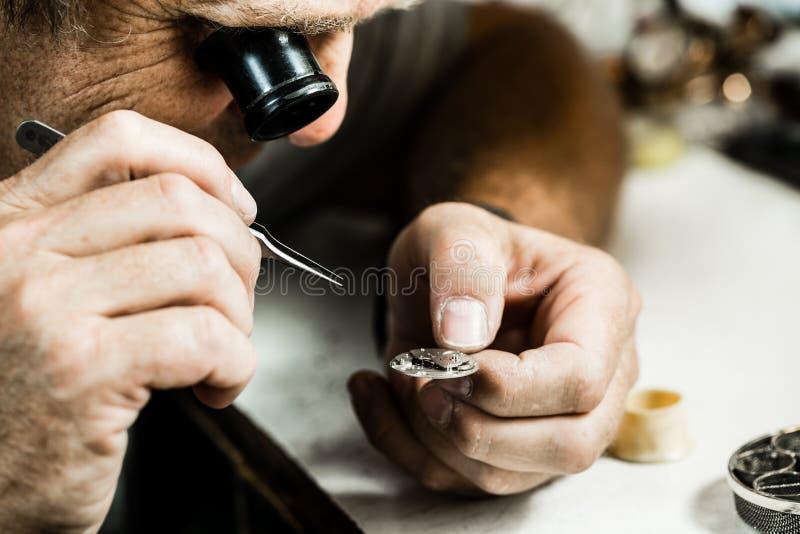 Clockmaker repairing wrist watch. Selective focus royalty free stock photos