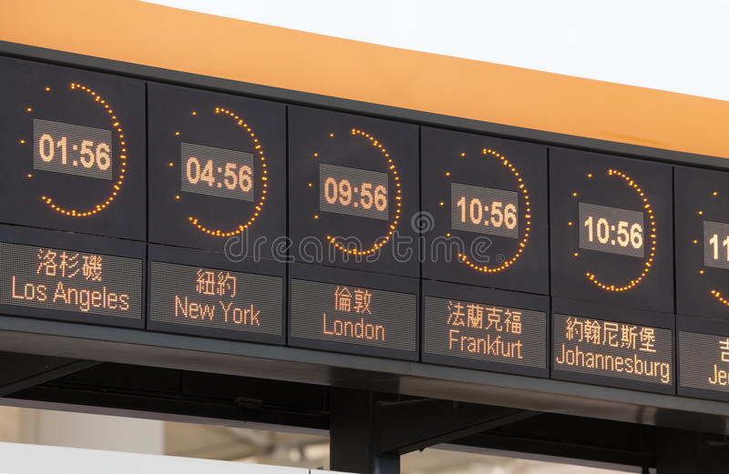 Clocks in an airport stock images