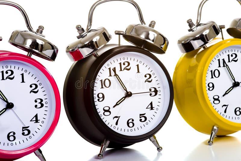 clocks färgrik white fotografering för bildbyråer