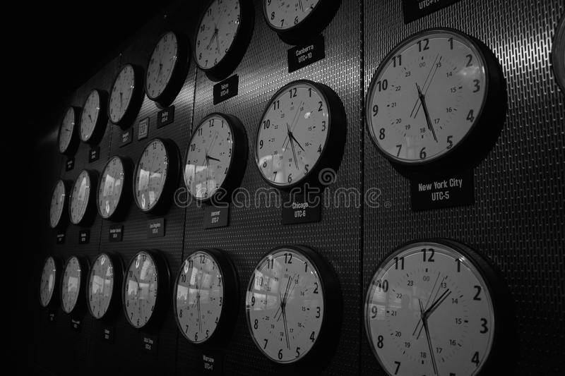 Clocks showing times around world. Rows of clocks with times in cities around the world. Date 2014 royalty free stock photos