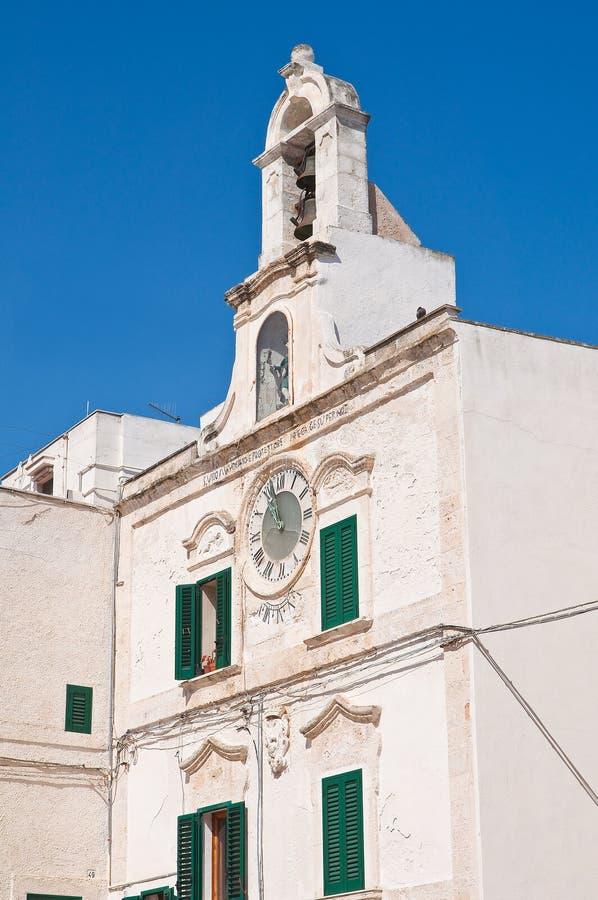 Clocktower Polignano en sto Puglia italy arkivbilder