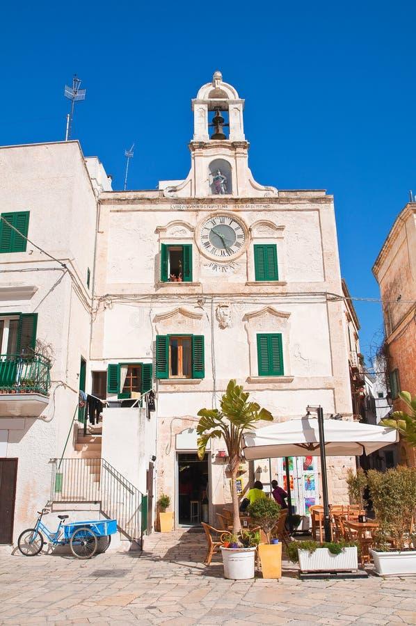 Clocktower Polignano en sto Puglia italy arkivfoton