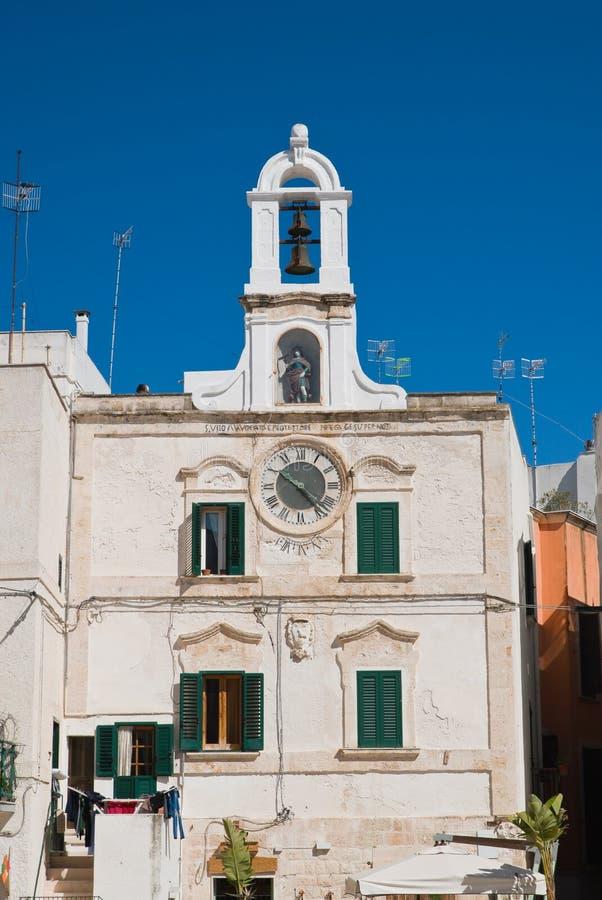 Clocktower Polignano en sto Puglia italy royaltyfri bild