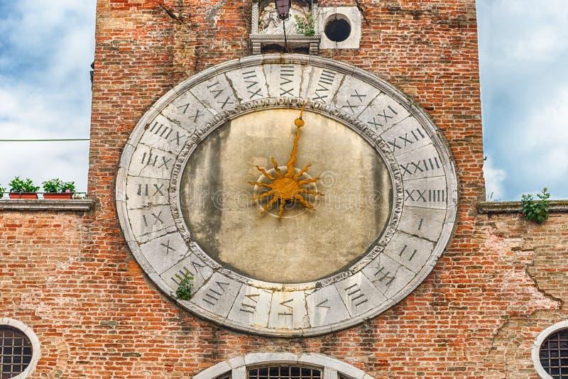 Clocktower of San Giacomo di Rialto Church, Venice, Italy. VENICE, ITALY - APRIL 29: Clocktower of San Giacomo di Rialto Church in San Polo district of Venice stock photography