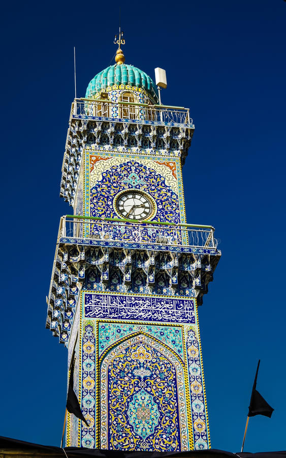 Clocktower van al-Kadhimiya aka Gouden Moskee in Bagdad Irak stock foto