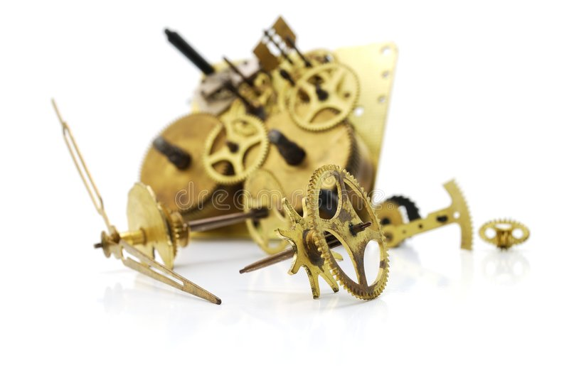 Clockwork. The image of the cogs, wheels and gears of the inside of an old clock royalty free stock photography