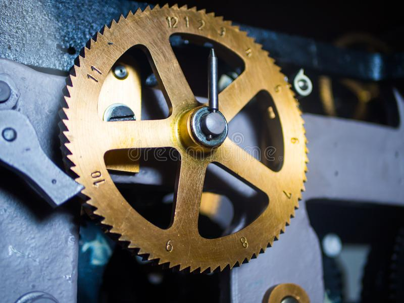 Bronze clock gear with numbers royalty free stock photos
