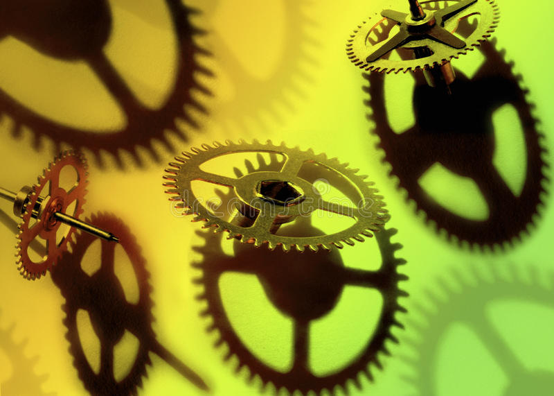 Industry - Clockwork cogs and parts from an old clock. Industry - Clockwork refers to the inner workings of either a mechanical clock or another device that stock photo