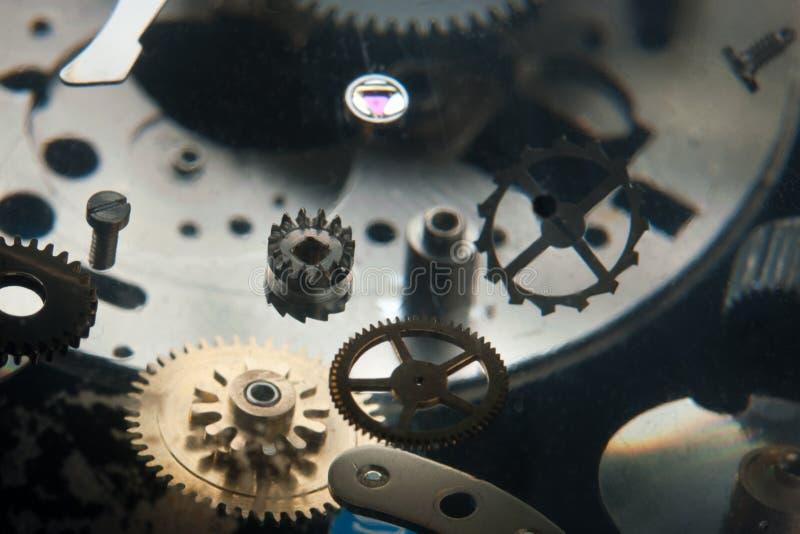 Clockwork. Fragmented with flying cogwheels stock photo