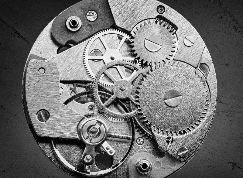 Clockwork with gears and cogwheels. In vintage style stock photography