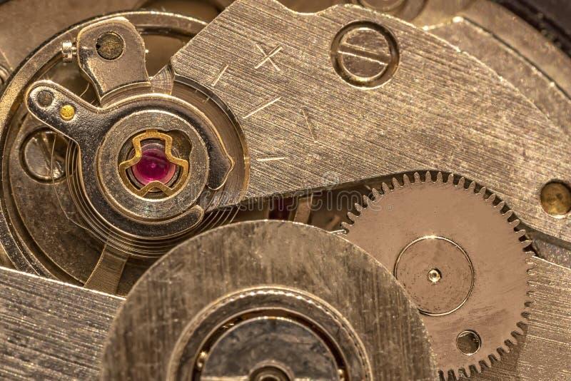 Clockwork gears inside the watch. Macro shot of clockwork gears inside the watch royalty free stock images