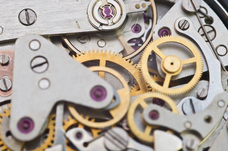 Clockwork, gears in an old watch. Teamwork concept, idea, technology, eternity, business. Clockwork, gears in an old watch. Teamwork concept idea technology royalty free stock images
