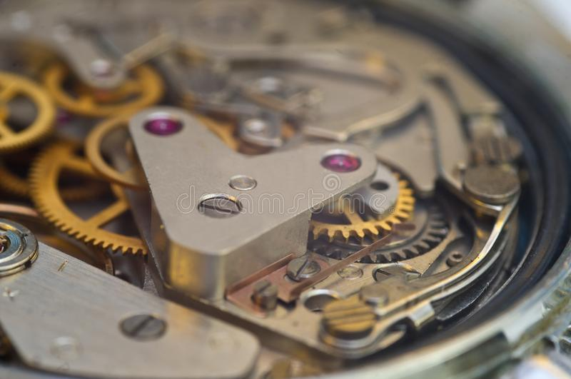 Clockwork, gears in an old watch. Teamwork concept, idea, technology, eternity, business. Macro. Clockwork, gears in an old watch. Teamwork concept idea stock photography