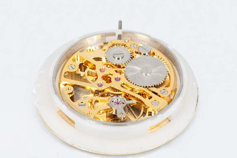 Clockwork mechanism of a pocket watch in gold, with jewels, close-up royalty free stock photography