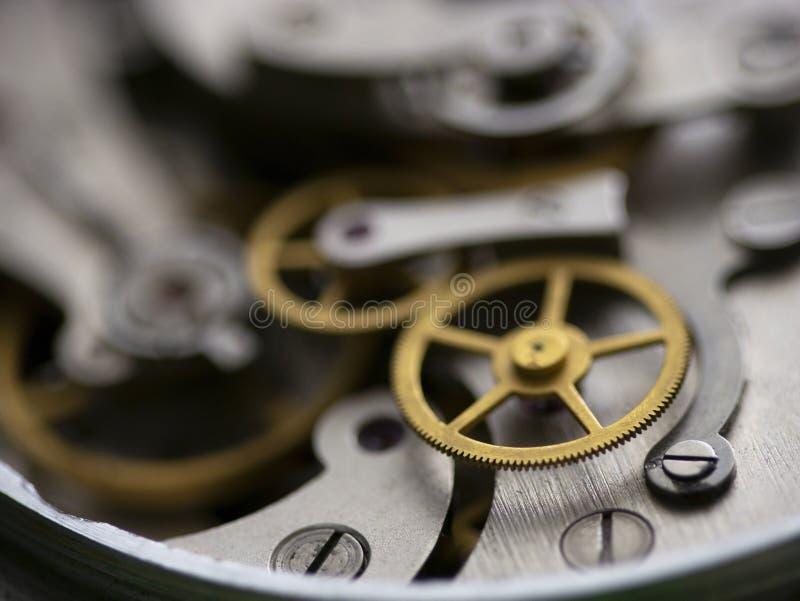 Clockworks-mechanisme van het oude wijnjaar macro-shot stock afbeeldingen