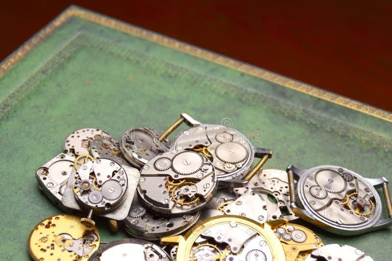 Clockworks on the table stock photos