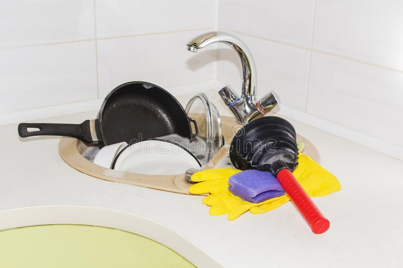 Clog in kitchen sink, obstruction of water. Clog pipes royalty free stock photography