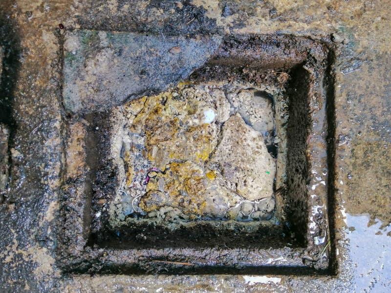 Clogged fat in the drain. Clogged fat in the drain, oli and grease royalty free stock photos