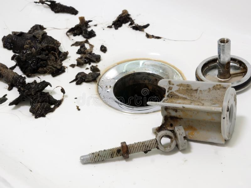 Clogged sink in bathroom and pipe cleaning. Clogged sink in the bathroom and pipe cleaning royalty free stock photos