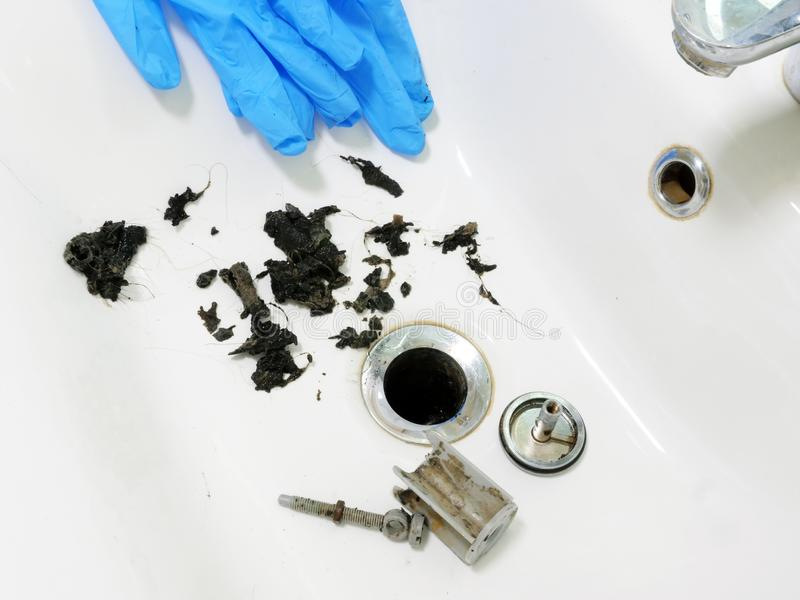 Clogged sink with mass of hair and grime royalty free stock images