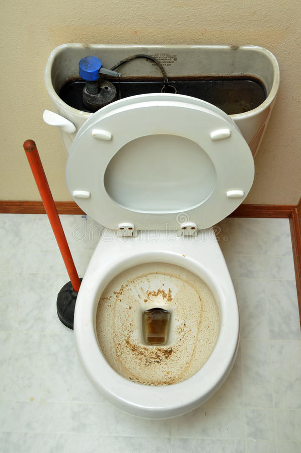 Clogged Toilet. Broken toilet due to large amounts of poop stock photo