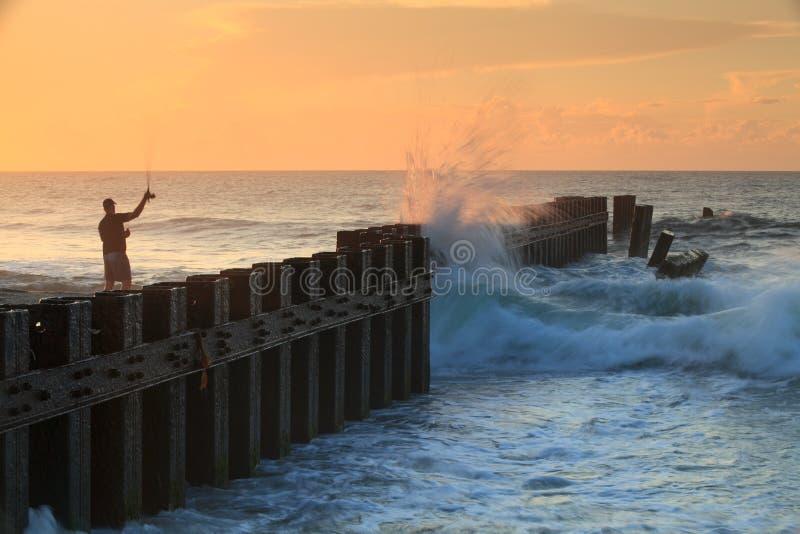 Cloison étanche en acier d'horizontal, aine, lever de soleil de pêcheur image libre de droits