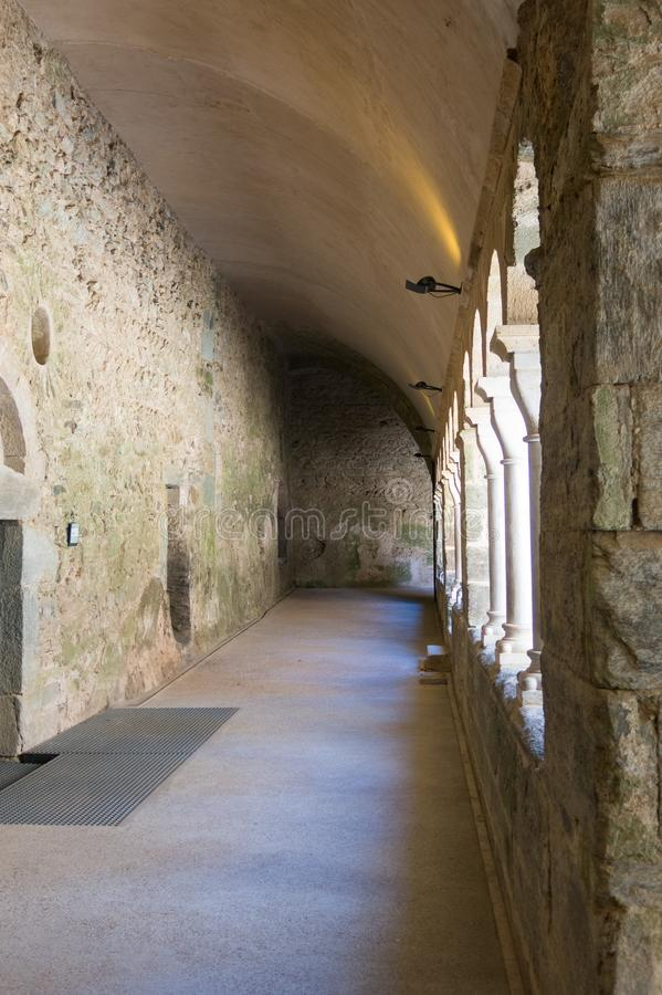 Cloister of the abbey of Sant Pere de Rodes, Spain. Cloister of the abbey of Sant Pere de Rodes. It is a former Benedictine monastery in the comarca of Alt stock image