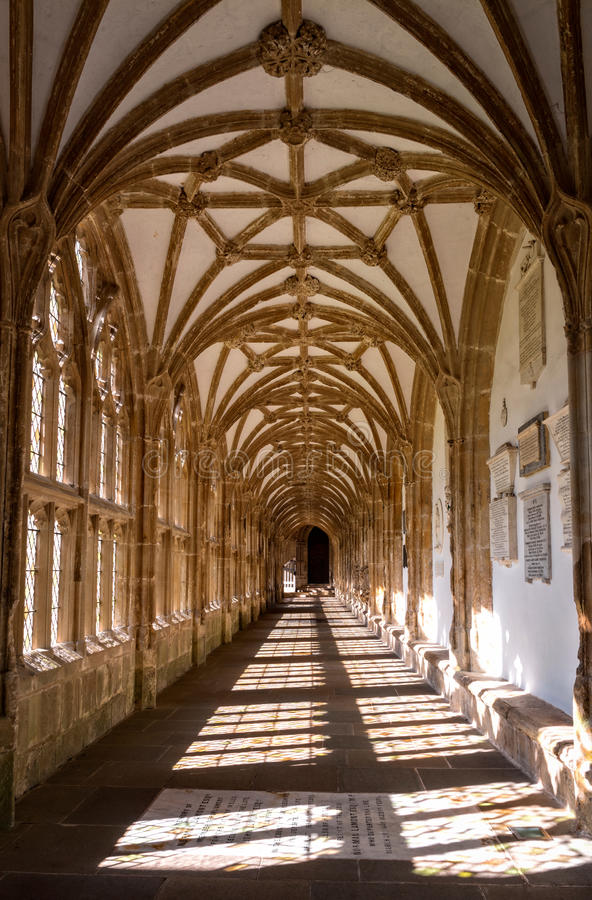 Cloister at Wells Cathedral. Wells, United Kingdom - August 6, 2016: View along cloister of Wells cathedral with lierne vault royalty free stock photos