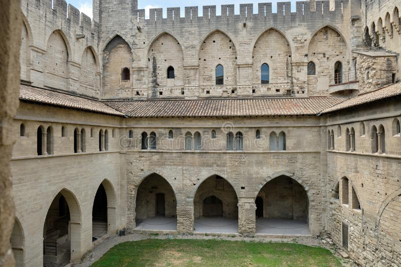 Cloisters and courtyard. At the Palais des Papes, Avignon , France royalty free stock images