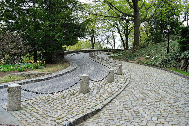 The Cloisters Driveway. Cobble stone road leading up to the Cloisters in New York City stock photo