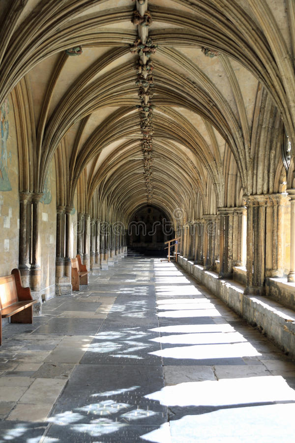 The Cloisters - Norwich Cathedral. He cathedral was begun in 1096 and constructed out of flint and mortar and faced with a cream-coloured Caen limestone. A Saxon royalty free stock photo