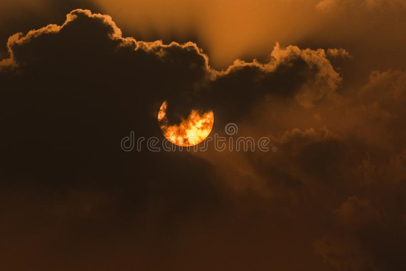 The Sun and clouds stock image