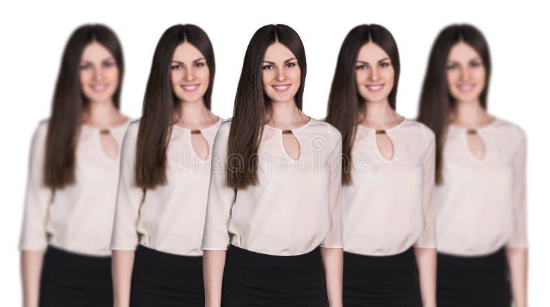 Clone das mulheres que estão em seguido fotos de stock royalty free