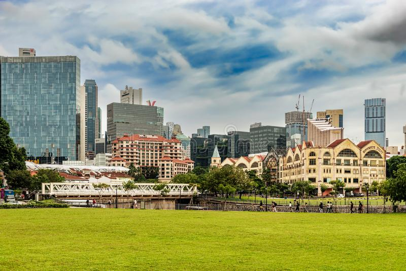 Clonial houses at the Singapore river and the cityscape. Singapore - Jan 11, 2018: Old colonial houses at Singapore River and the downtown core high rise royalty free stock image