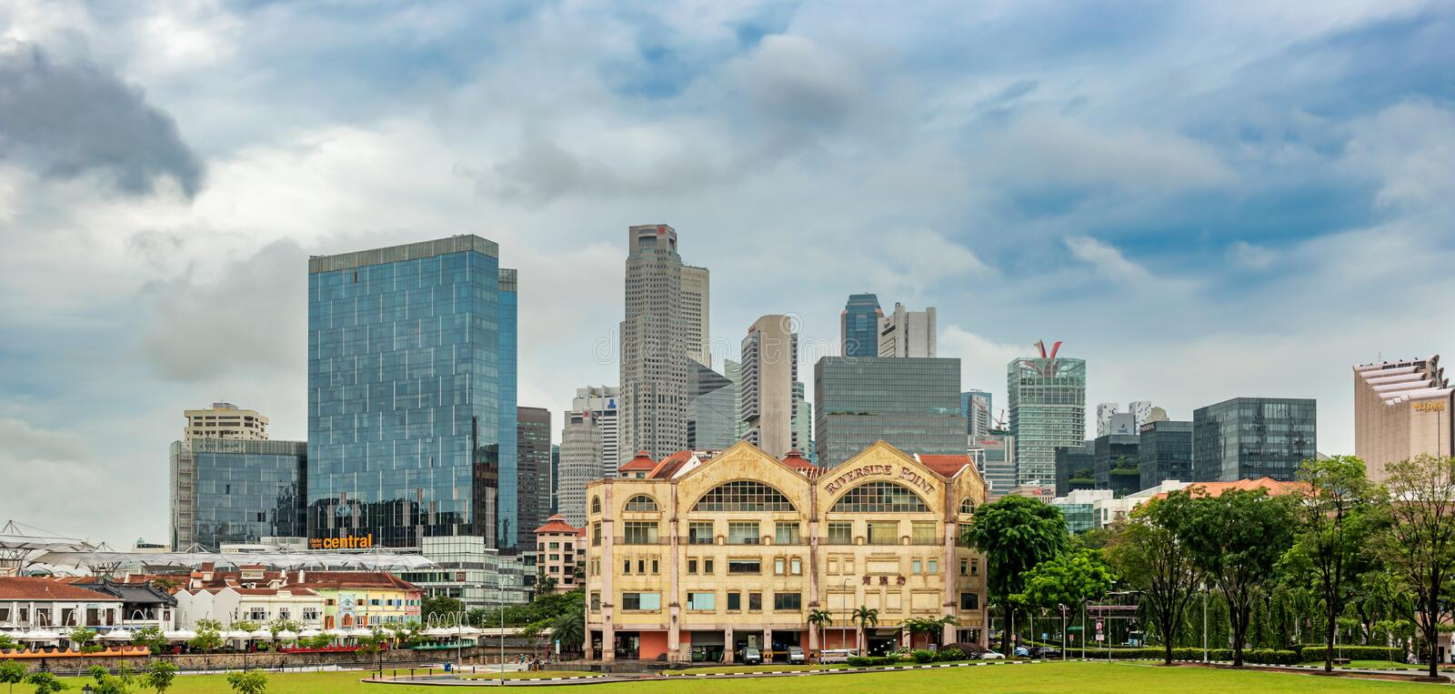 Clonial houses at the Singapore river and the cityscape. Singapore - Jan 11, 2018: Old colonial houses at Singapore River and the downtown core high rise stock photography