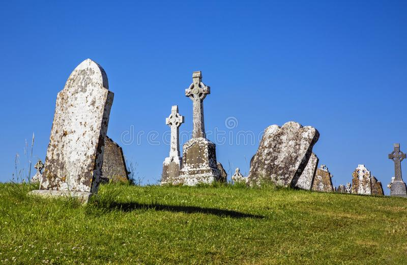 Clonmacnoise Cathedral  with the typical crosses and graves. The monastery ruins. Ireland royalty free stock image
